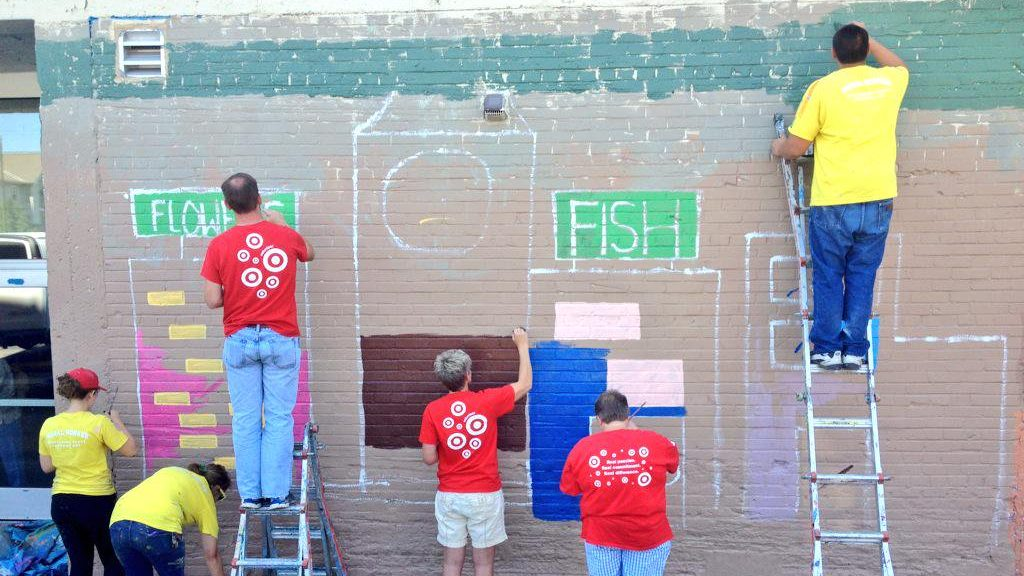 Volunteers working on a mural
